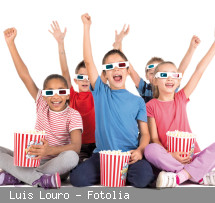 Group of children with 3d glasses and popcorn